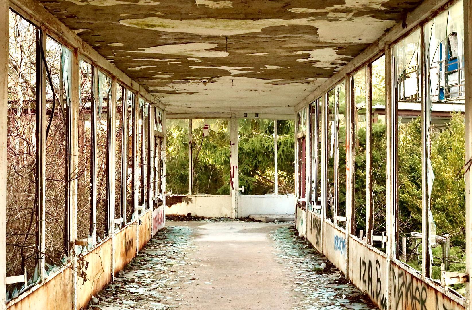 A corridor through an abandoned building