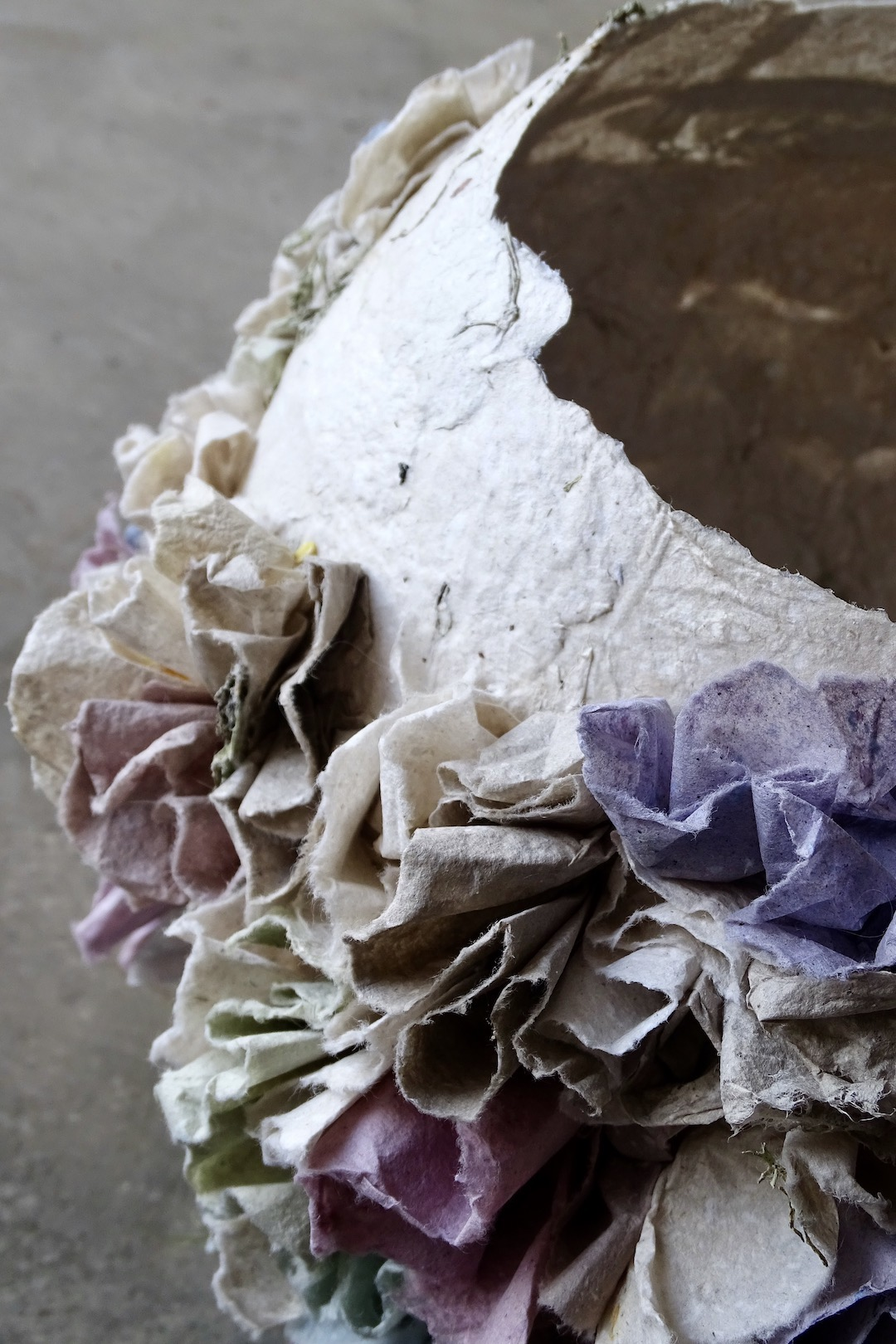 A close up of the paper ruffles in natural tones