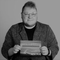 An image of Lawrence holding his printed book.